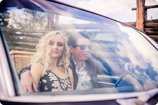 convertible-Cadillac_engagement-portraits_travel-cherry-orchard_Okanagan_07_by-Kevin-Trowbridge