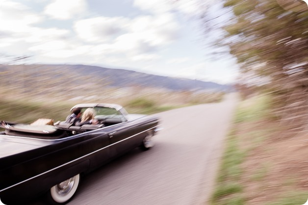 convertible-Cadillac_engagement-portraits_travel-cherry-orchard_Okanagan_24_by-Kevin-Trowbridge
