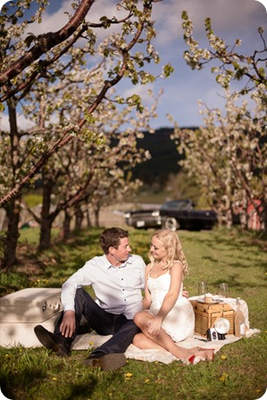 convertible-Cadillac_engagement-portraits_travel-cherry-orchard_Okanagan_54_by-Kevin-Trowbridge