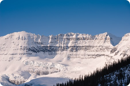 Lake-Louise-wedding-photographer_Fairmont-engagement-portraits_skating-ice-sculpture-festival___by-Kevin-Trowbridge-6