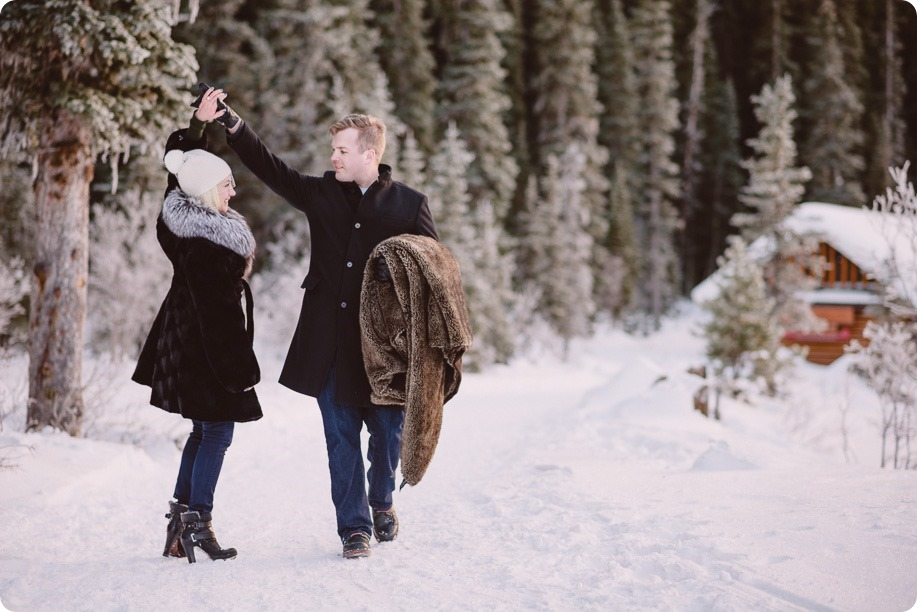 Lake-Louise-wedding-photographer_Fairmont-engagement-portraits_skating-ice-sculpture-festival___by-Kevin-Trowbridge-163