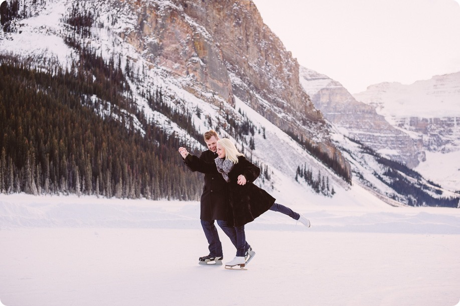 Lake-Louise-wedding-photographer_Fairmont-engagement-portraits_skating-ice-sculpture-festival___by-Kevin-Trowbridge-183