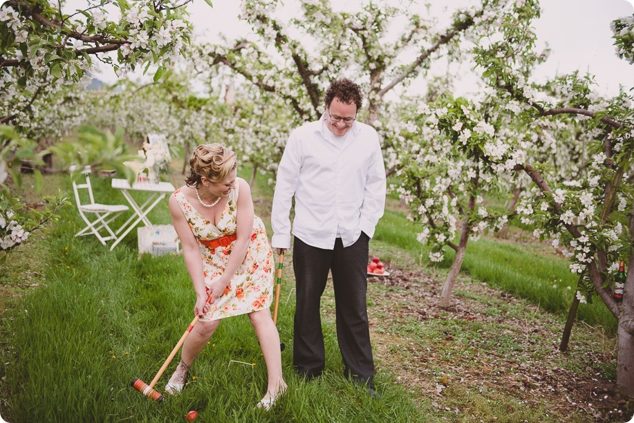Kelowna-engagement-session_orchard-blossom_croquet-portraits_vintage-floral-dress_53_by-Kevin-Trowbridge