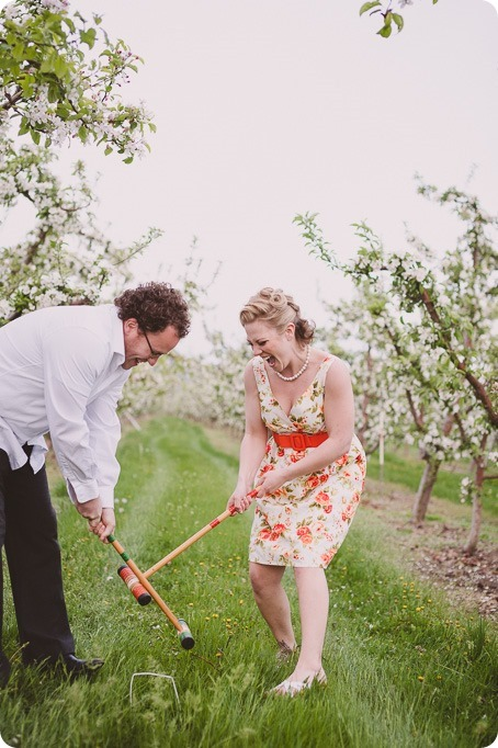 Kelowna-engagement-session_orchard-blossom_croquet-portraits_vintage-floral-dress_54_by-Kevin-Trowbridge