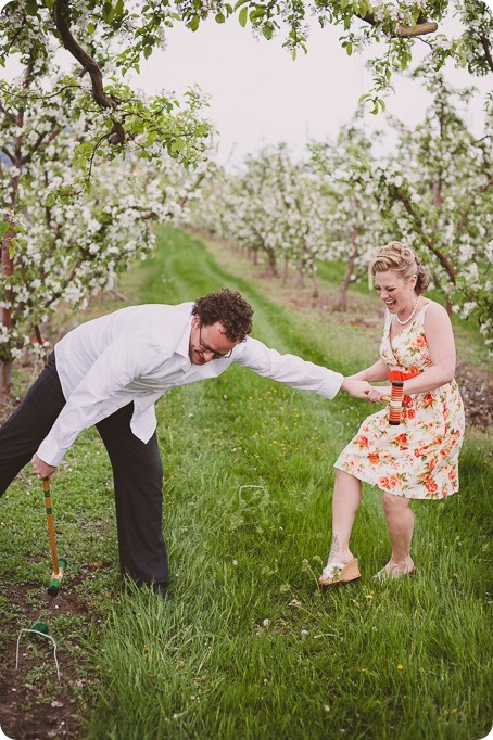 Kelowna-engagement-session_orchard-blossom_croquet-portraits_vintage-floral-dress_56_by-Kevin-Trowbridge