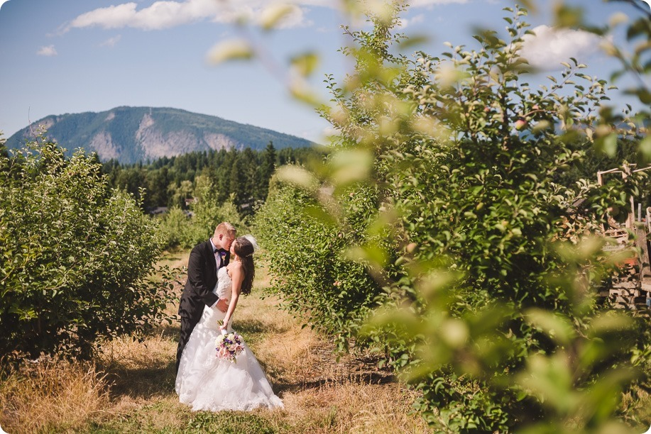 Enderby-wedding_orchard-bridge-sparklers_Okanagan_162706_by-Kevin-Trowbridge