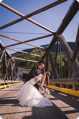 Enderby-wedding_orchard-bridge-sparklers_Okanagan_181802_by-Kevin-Trowbridge